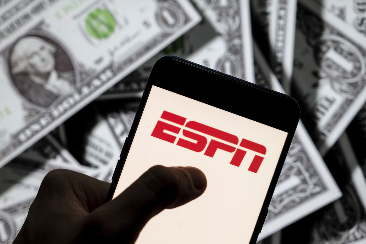 In this photo illustration, an ESPN logo seen displayed on a...