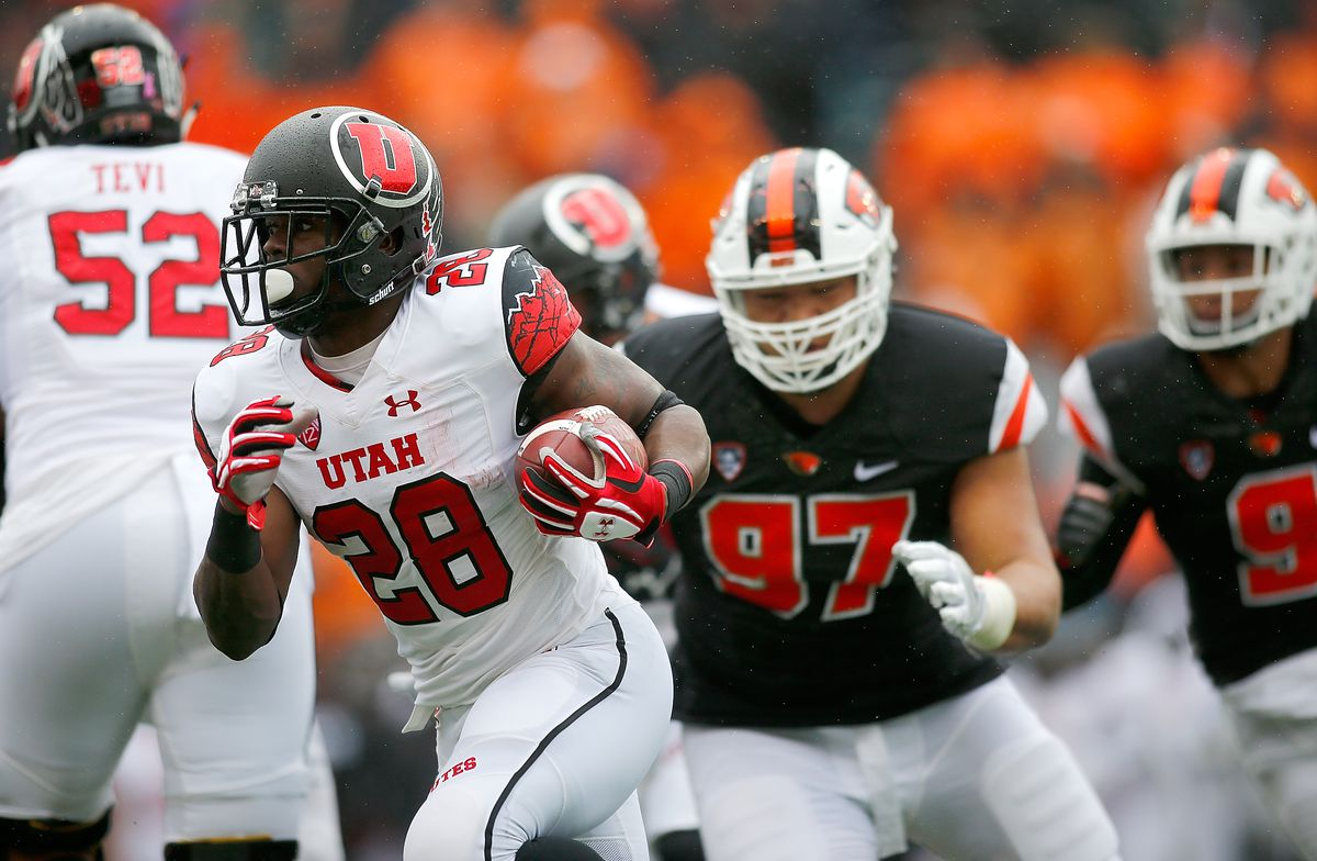 CORVALLIS, OR - Utah Utes right tackle Sam Tevi (52) helps clear the way for running back Joe Williams (28) against the Oregon State Beavers defense at Reser Stadium.