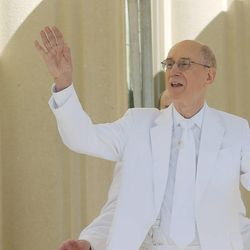 President Henry B. Eyring  waves to the choir after placing mortar in the cornerstone during the Payson Utah Temple cornerstone ceremony in Payson  Sunday, June 7, 2015.