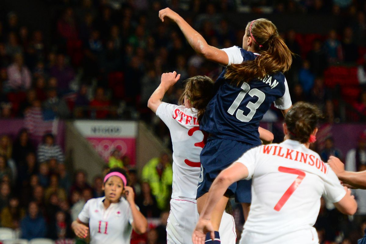 Aug 6, 2012; Manchester , United Kingdom; USA forward (13) Alex Morgan heads the winning goal in extra time against Canada in the semi finals during the London 2012 Olympic Games at Old Trafford. Mandatory Credit: Mark J. Rebilas-USA TODAY Sports