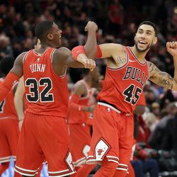 Chicago Bulls guard Kris Dunn, left, celebrates with Denzel Valentine after the Chicago Bulls defeated the Utah Jazz 103-100 in an NBA basketball game Wednesday, Dec. 13, 2017, in Chicago. (AP Photo/Nam Y. Huh)
