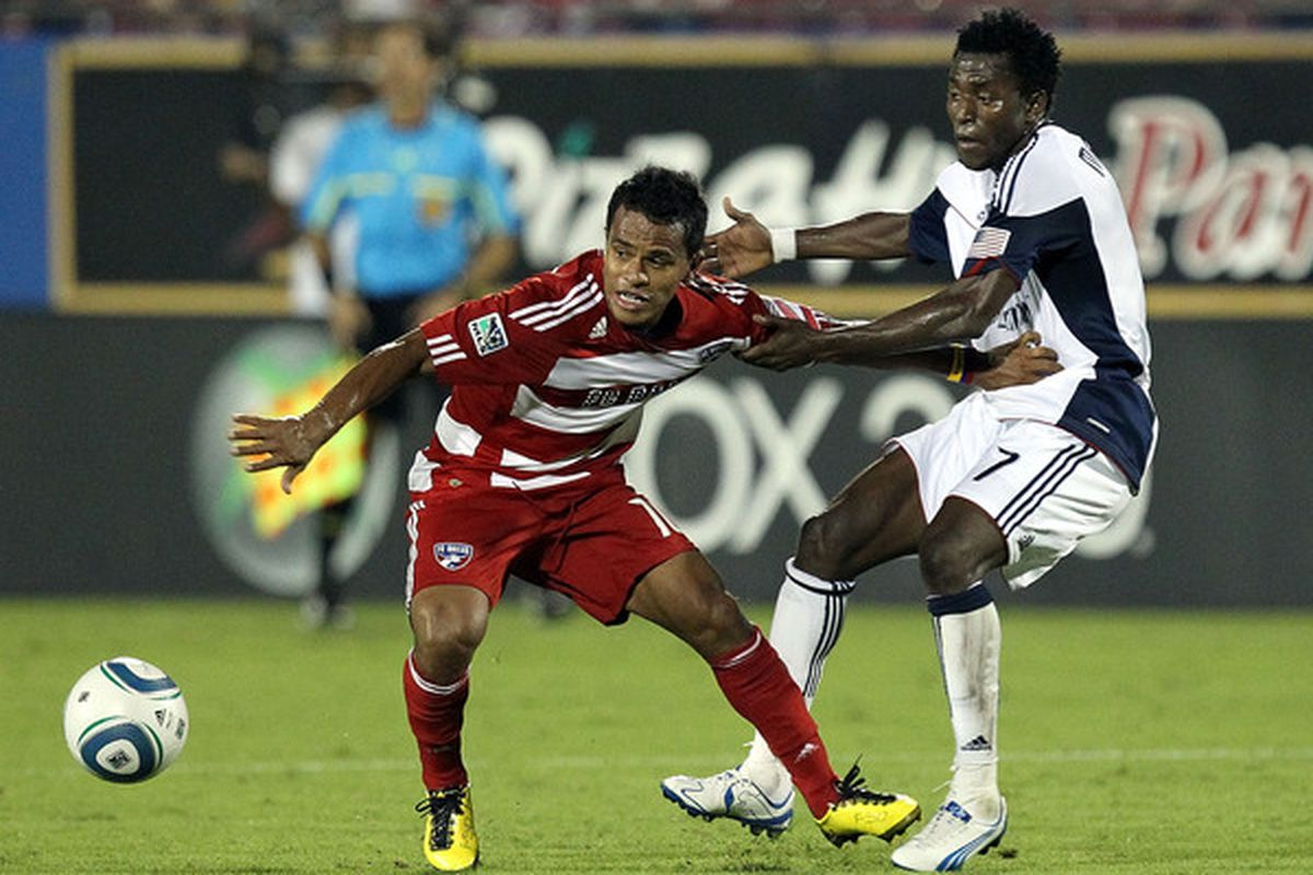FRISCO TX - SEPTEMBER 22:  Midfielder David Ferreira #10 of FC Dallas dribbles the ball past Kenny Mansally #7 of the New England Revolution at Pizza Hut Park on September 22 2010 in Frisco Texas.  (Photo by Ronald Martinez/Getty Images)