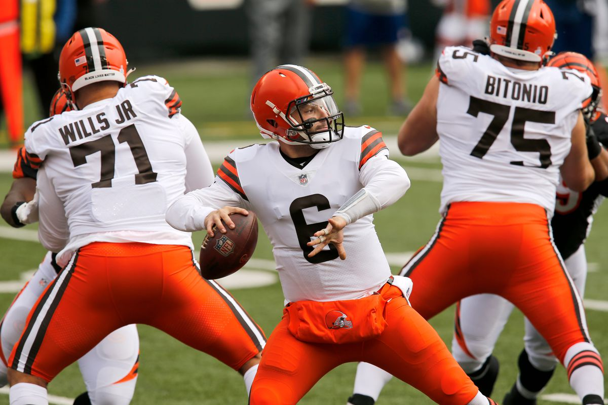 Cleveland Browns quarterback Baker Mayfield (6) drops back to throw a deep pass intended for wide receiver Odell Beckham Jr. (13), which is intercepted by Cincinnati Bengals cornerback Darius Phillips (23) in the first quarter of the NFL Week 7 game between the Cincinnati Bengals and the Cleveland Browns at Paul Brown Stadium in downtown Cincinnati on Sunday, Oct. 25, 2020.
