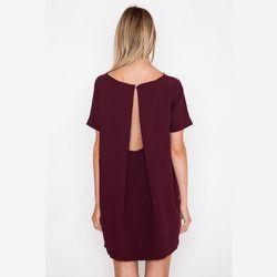 "<strong>Kaarem</strong> Burgundy Angle Mini Dolman Open Back Dress, <a href=""https://shopacrimony.com/products/kaarem-burgundy-angle-mini-dolman-open-back-dress"">$260</a> at Acrimony"
