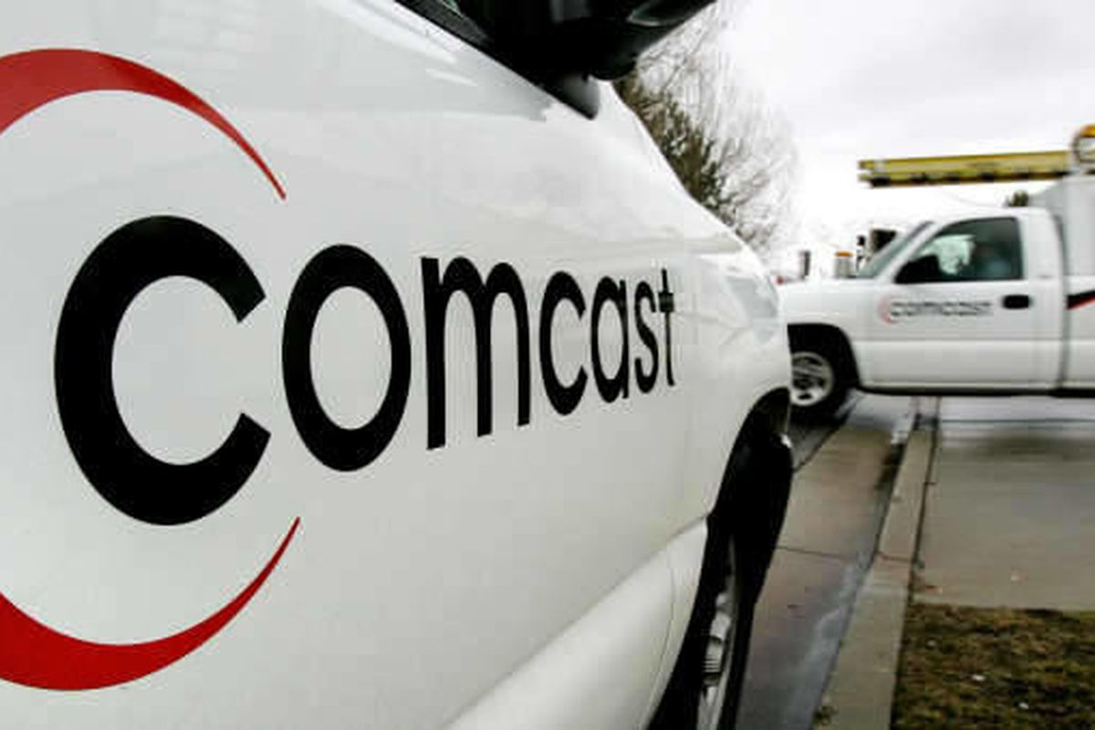 FILE - In this Feb. 2, 2006 file photo, a technician for Comcast heads out on a job in a Salt Lake City. Six months after launching a new network of more than 1,000 Wi-Fi hotspots across the state, Comcast is broadening the program. The company announced