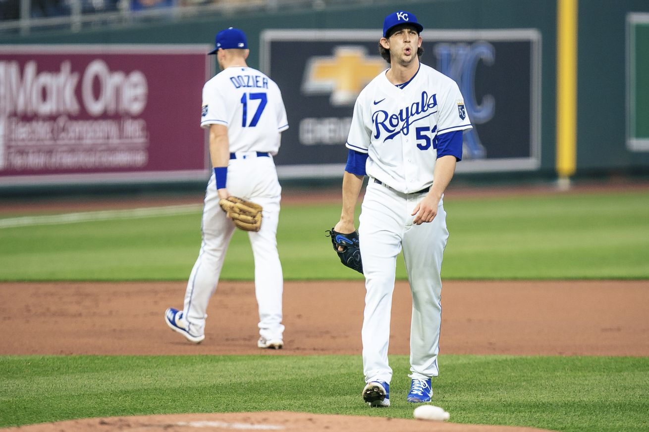 Daniel Lynch #52 of the Kansas City Royals reacts to his out in the first inning against the Cleveland Indians at Kauffman Stadium on May 3, 2021 in Kansas City, Missouri. Lynch is making is major league debut.