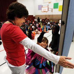 Assistant Principal Ruth Jackman greets Riley during the Breakfast in the Classroom program at Backman Elementary School in Salt Lake City on Friday, Oct. 28, 2016.
