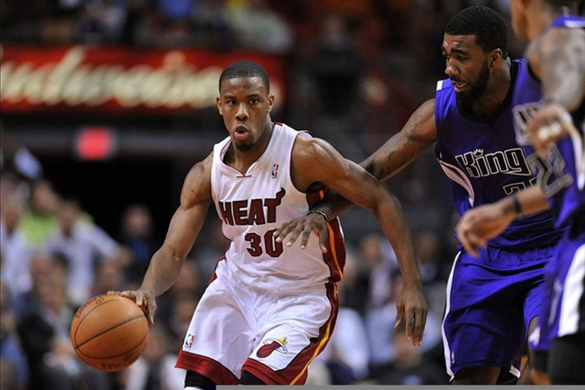 Feb. 21, 2012; Miami, FL, USA; Miami Heat point guard Norris Cole (30) dribbles past Sacramento Kings center Jason Thompson (34) during the second half at American Airlines Arena. Mandatory Credit: Steve Mitchell-US PRESSWIRE