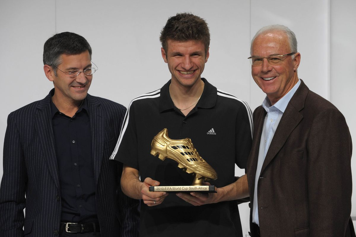 (L-R) CEO of the German sportswear and e
