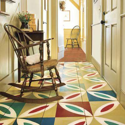 Foyer with multi-color decorative paint on floors.