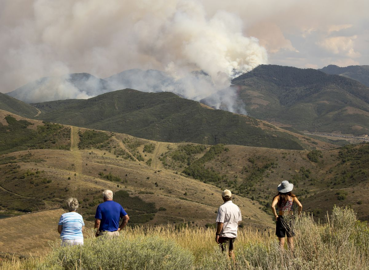 Onlookers watch from Little Mountain as aircraft battle the Parley's Canyon fire on Saturday, Aug. 14, 2021.