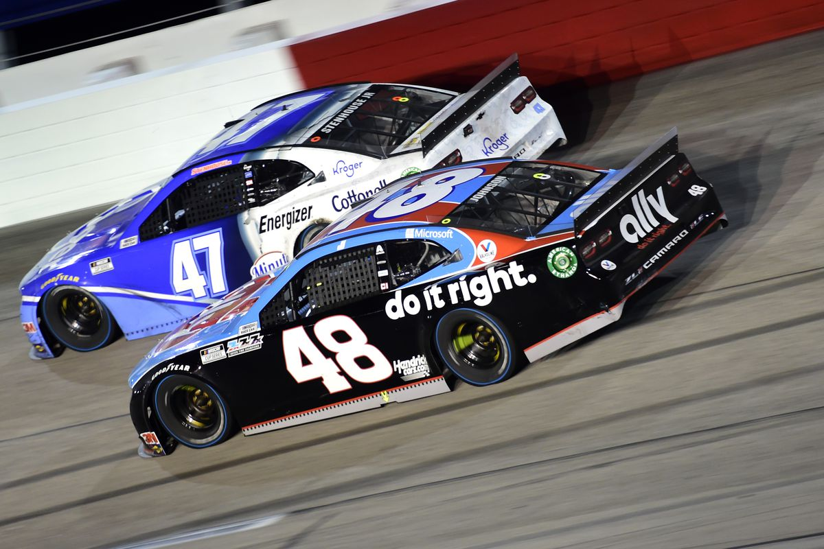 Jimmie Johnson, driver of the #48 Ally Throwback Chevrolet, and Ricky Stenhouse Jr., driver of the #47 Kroger Chevrolet, race during the NASCAR Cup Series Cook Out Southern 500 at Darlington Raceway on September 06, 2020 in Darlington, South Carolina.