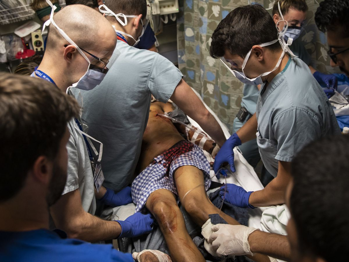Emergency room doctors at Mount Sinai Hospital insert a chest tube to treat a man who suffered a collapsed lung when he was stabbed on the Southwest Side.
