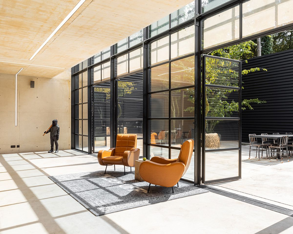 Room with open doors leading to sunken courtyard
