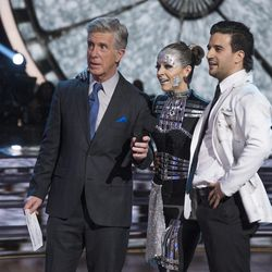 """Violinist Lindsey Stirling and dance pro Mark Ballas with host Tom Bergeron after dancing an Argentine tango with a sci-fi theme during """"A Night at the Movies"""" theme night on """"Dancing with the Stars"""" on Monday, Oct. 23."""