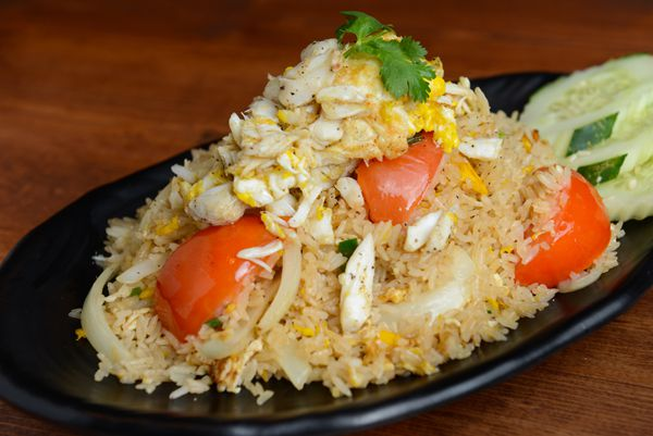 A plate of fried rice with bell peppers