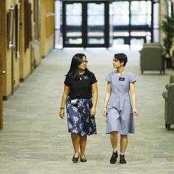Sister Fanny Clain, right, and her companion Aniela Santoso walk the halls in the Missionary Training Center in Provo May 27, 2016. Clain was a victim of the Brussels terrorist attack. She has recovered and is now leaving to the Ohio Cleveland Mission.