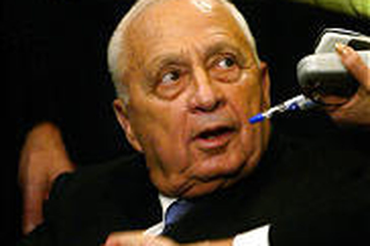 Israeli Prime Minister Ariel Sharon receives congratulations from members of the Knesset Tuesday.