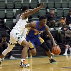 Simeon's Kejuan Clements (0) holds off Morgan Park's Adam Miller (44) in their CPS semi final game at Chicago State University, Friday, February 15, 2019. | Kevin Tanaka/For the Sun Times