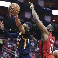 Utah Jazz guard Mike Conley, left, drives to the basket as Houston Rockets guard James Harden defends during the second half of an NBA basketball game, Sunday, Feb. 9, 2020, in Houston.