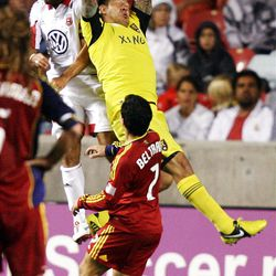 Goalkeeper Nick Rimando of Real Salt Lake makes a save in front of teammate Tony Beltran and Dwayne De Rosario of DC United during their MLS matchup at Rio Tinto Stadium in Sandy Saturday, September 1, 2012