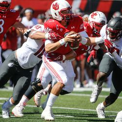 Utah quarterback Cameron Rising (7) gets pressured Washington State defense compete during an NCAA college football game at Rice-Eccles Stadium on Saturday, Sept. 25, 2021 in Salt Lake City.