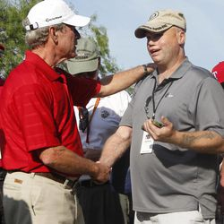 Former President George W. Bush, left, talks with retired U.S. Army Staff Sgt. Jerry Majetich  during the Bush Center Warrior Open in Irving, Texas, Monday, Sept. 24, 2012. The Warrior Open is a two-day golf tournament featuring members of the U.S. Armed Forces who were severely wounded during the global war against terrorism.