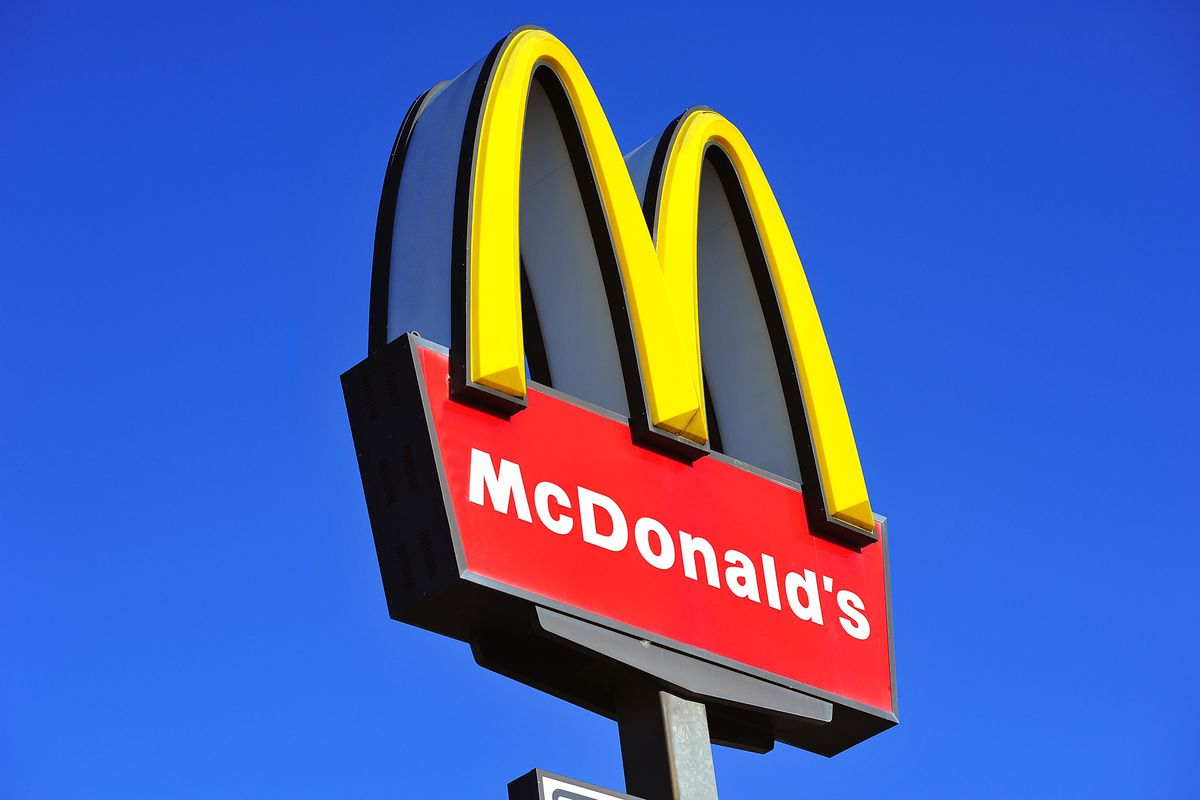 A photo of the golden arches over a McDonald's restaurant.