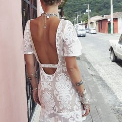 """""""If some of my styles have open backs, and you are the kind of person that doesn't need to wear a bra, then don't! If you need to wear a bra, I tell customers that it is okay to have a smidge of that bralette show in the back.""""  For Love & Lemons embroide"""