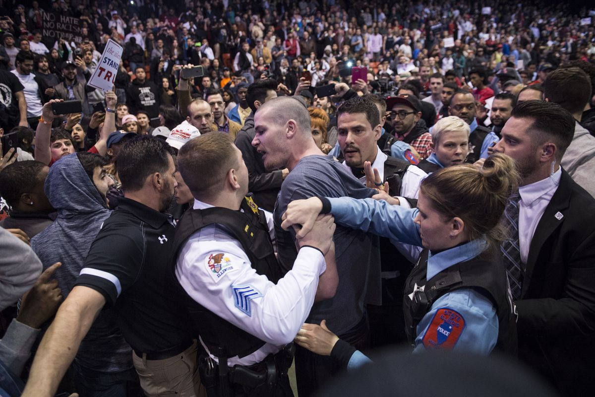A fight between supporters and protesters at Donald Trump's cancelled rally in Chicago.