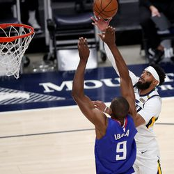 Utah Jazz guard Mike Conley (10) puts up a shot over LA Clippers forward Serge Ibaka (9) as the Utah Jazz and LA Clippers play in an NBA basketball game at Vivint Smart Home Arena in Salt Lake City on Friday, Jan. 1, 2021. Utah won 106-100.