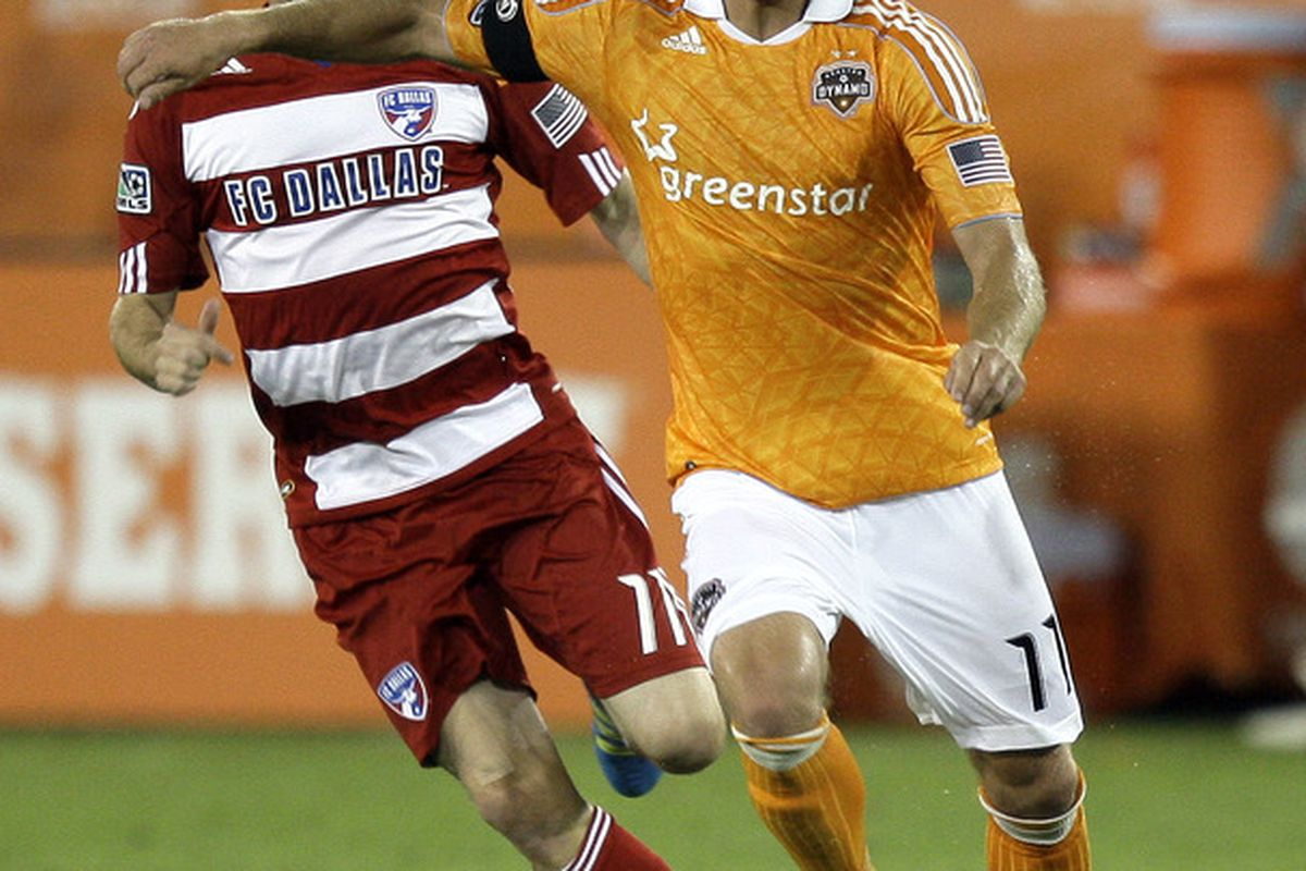 HOUSTON - MAY 28: Brad Davis #11 of the Houston Dynamo fends off Ricardo Villar #11 of FC Dallas as he brings the ball up the field in the second half at Robertson Stadium on May 28, 2011 in Houston, Texas. (Photo by Bob Levey/Getty Images)