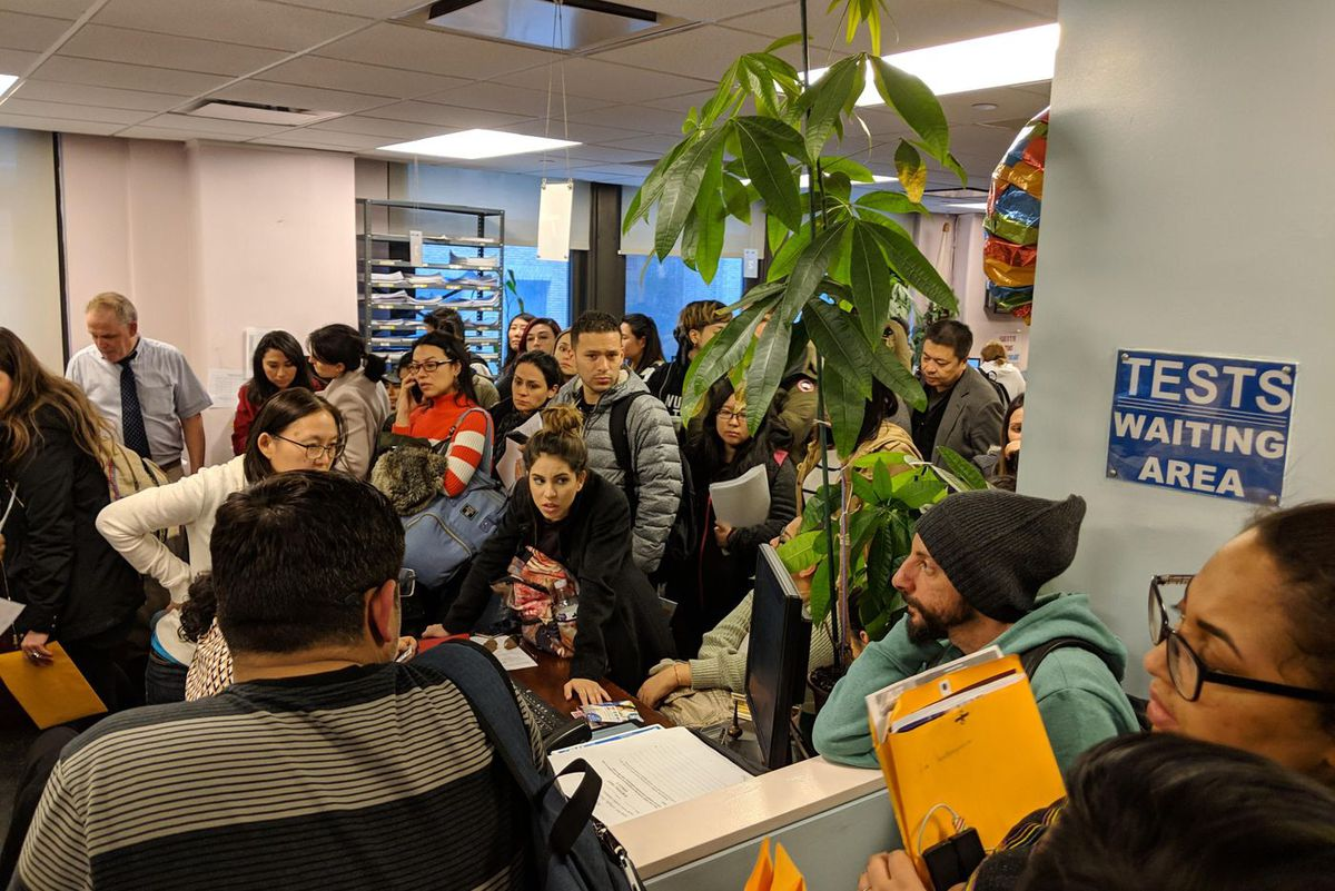 Students crowd the ALCC offices in Midtown on Wednesday, April 3, waiting for staff to release documents needed to transfer to other language schools.