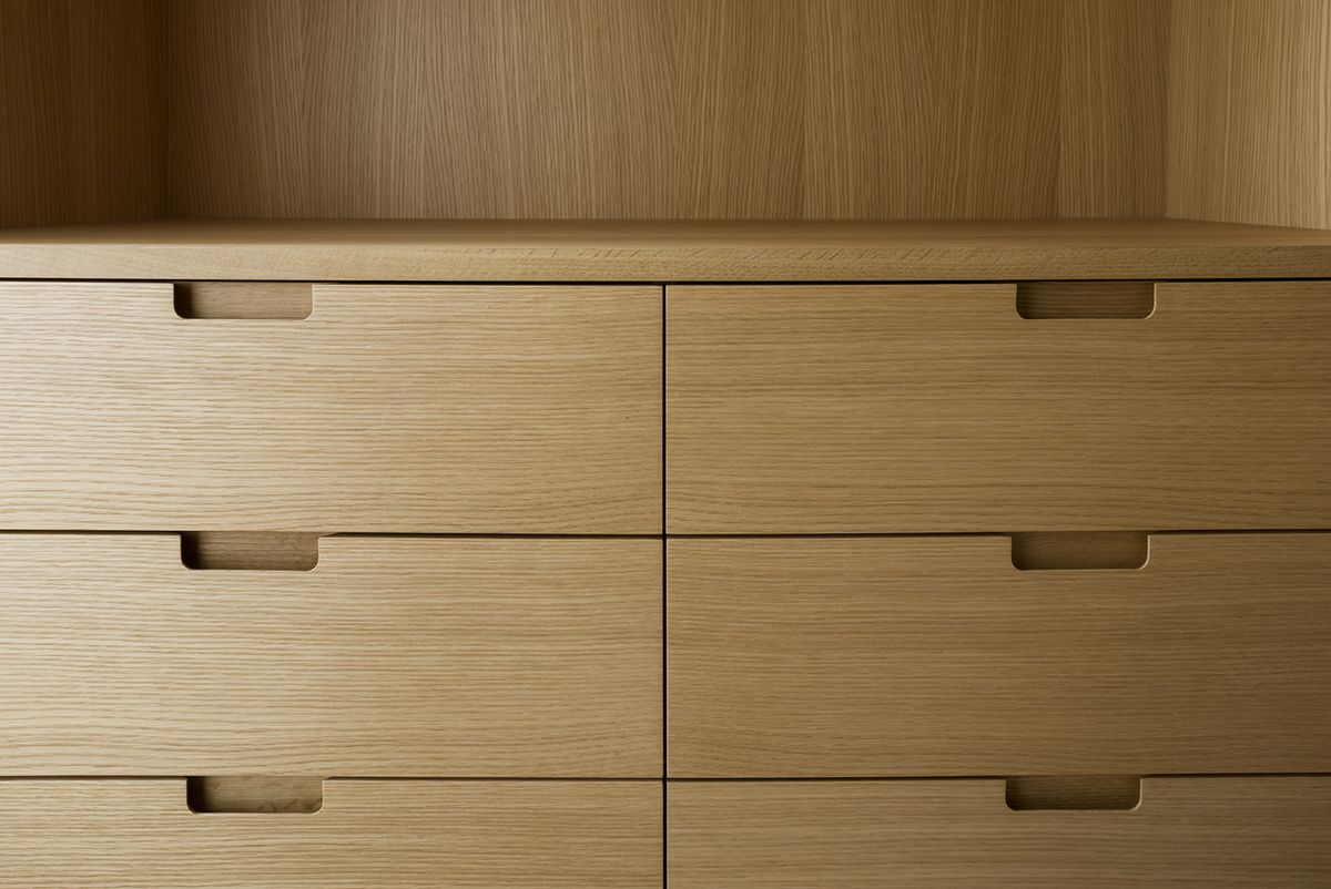 A detail of the built-in closet cabinetry in rift sawn white oak.