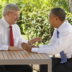 FILE - In this Nov. 13, 2011, file photo, Canadian Prime Minister Stephen Harper, left, talks with U.S. President Barack Obama following the first plenary session of the Asia-Pacific Economic Cooperation summit in Kapolei, Hawaii. Obama is convening a summit with leaders from Mexico and Canada on Monday, April 2, 2012, that aims to boost a fragile recovery and grapple with thorny energy issues against a backdrop of painfully high gas prices. The session at the White House is a make-good for a planned meeting last November in Hawaii on the sidelines of the Asia-Pacific summit. Obama ended up meeting just with Harper when Mexican President Felipe Calderon's top deputy was killed in a helicopter crash.