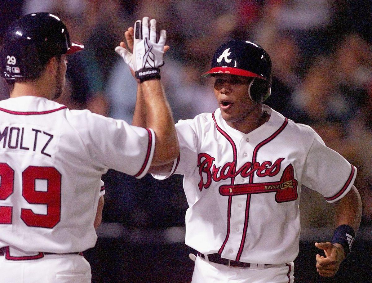 Andruw Jones (R) of the Atlanta Braves is congratu