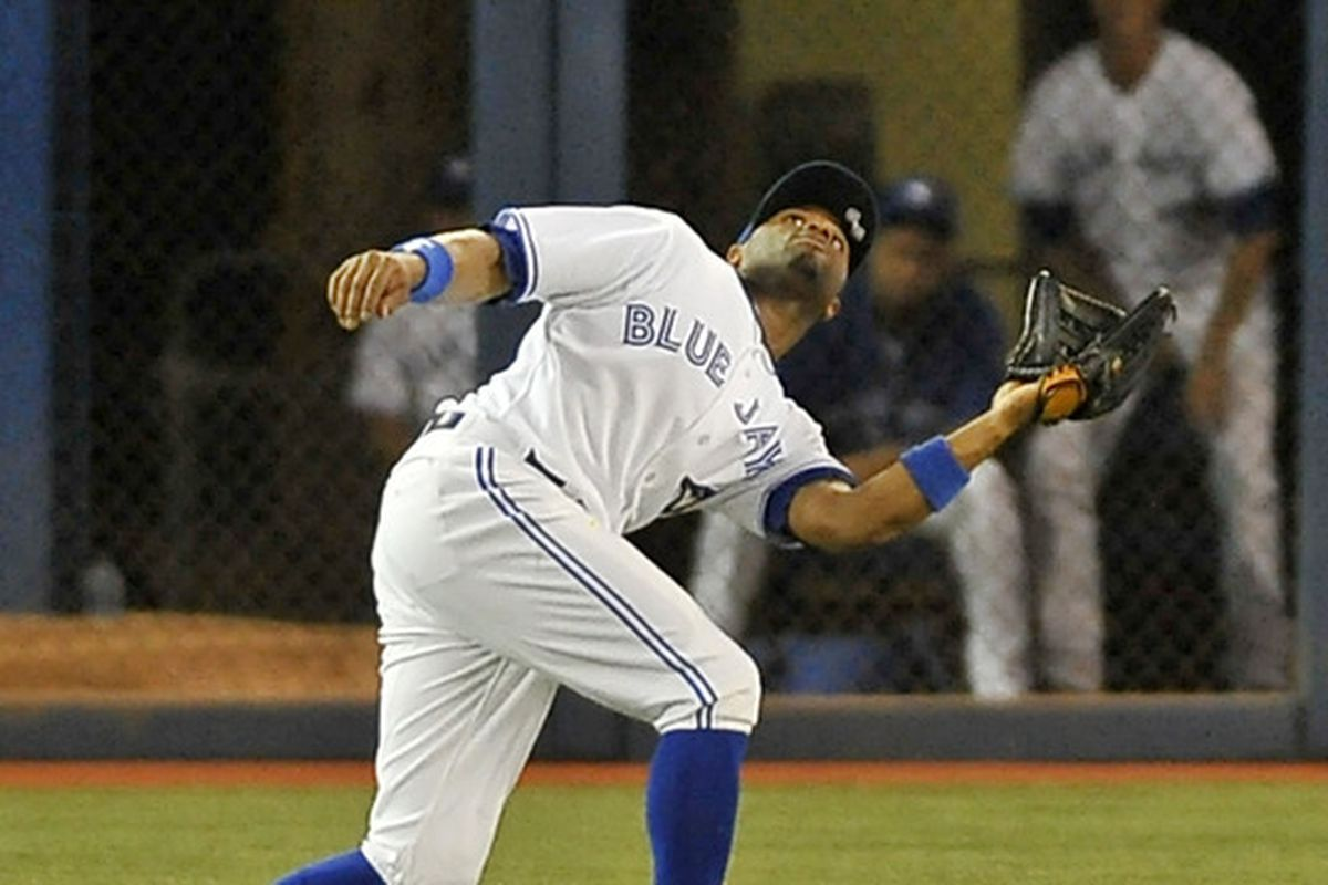TORONTO, CANADA - JULY 2:  Rajai Davis #11 of the Toronto Blue Jays makes a catch in the outfield during MLB game action against the Kansas City Royals July 2, 2012 at Rogers Centre in Toronto, Ontario, Canada. (Photo by Brad White/Getty Images)