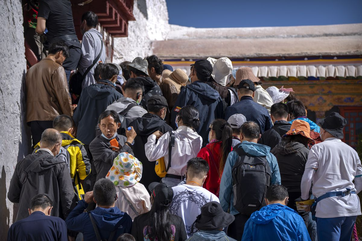 Tourists wait to climb the steps of an interior space of the Potala Palace in Lhasa, in the Tibet Autonomous Region (western China).