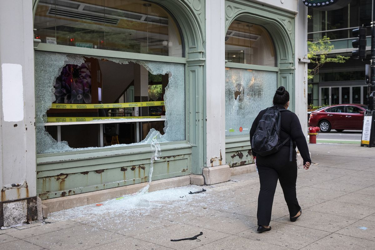 A person walks past a McDonald's restaurant at 36 W. Randolph St. after looting broke out overnight in the Loop and surrounding neighborhoods, Monday morning.