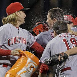 Cincinnati Reds pitcher Homer Bailey, right rear, celebrates with teammates Bronson Arroyo, left, and Joey Votto (19) after pitching a no-hitter in a baseball game against the Pittsburgh Pirates in Pittsburgh Friday, Sept. 28, 2012. The Reds won 1-0.