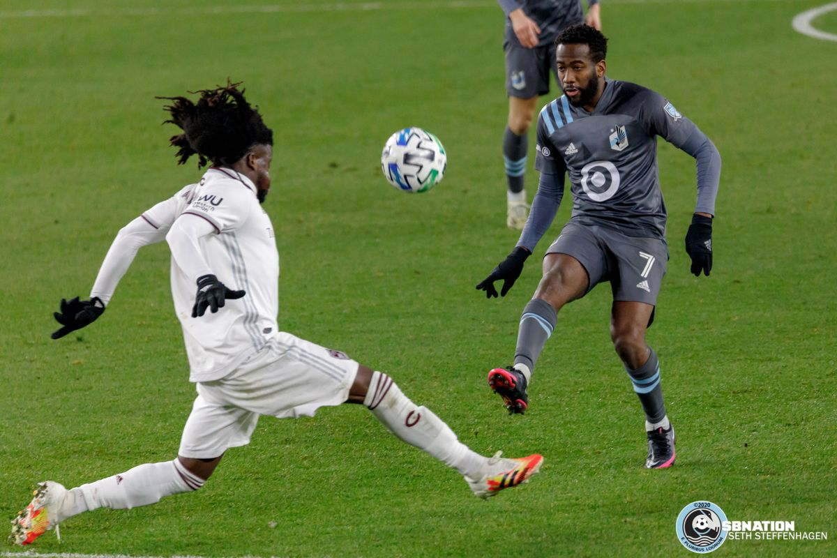 November 22, 2020 - Saint Paul, Minnesota, United States - Minnesota United midfielder Kevin Molino (7) chips the ball over Colorado Rapids defender Lalas Abubakar (6) during the first round playoff match at Allianz Field.