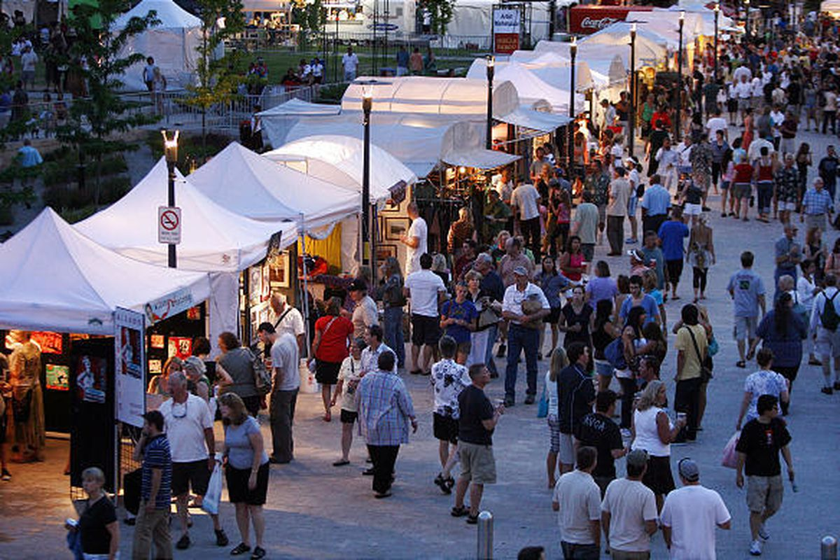 Crowds look over the artists' booths at the 2008 Utah Arts Festival. This year's festival has scaled back somewhat.