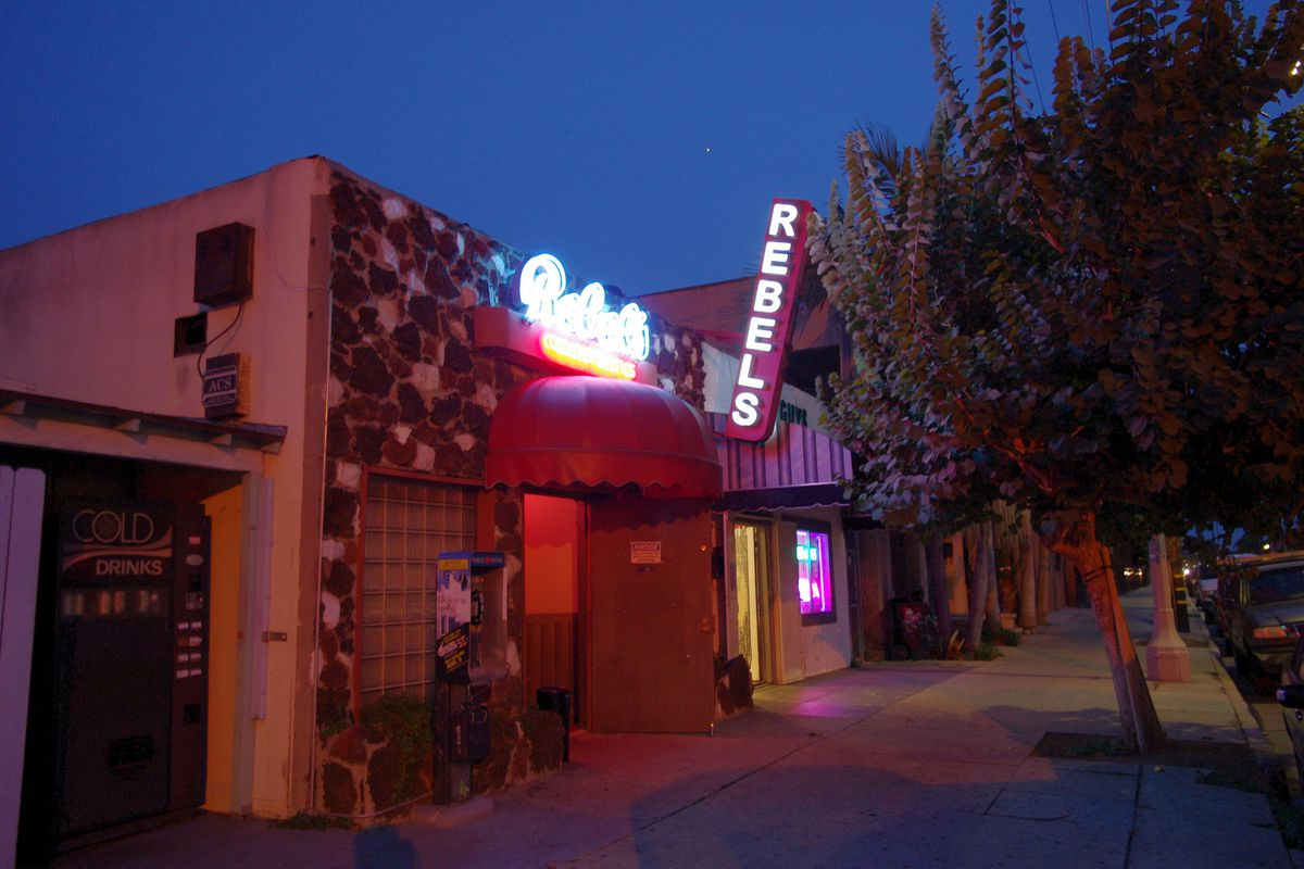 View of bar with neon sign