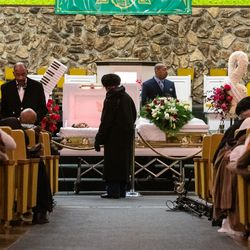 A mourner pays respects to Pastor Maceo L. Woods during the wake and funeral for Woods at Christian Tabernacle Church, Saturday, Jan. 18, 2020, in Chicago.
