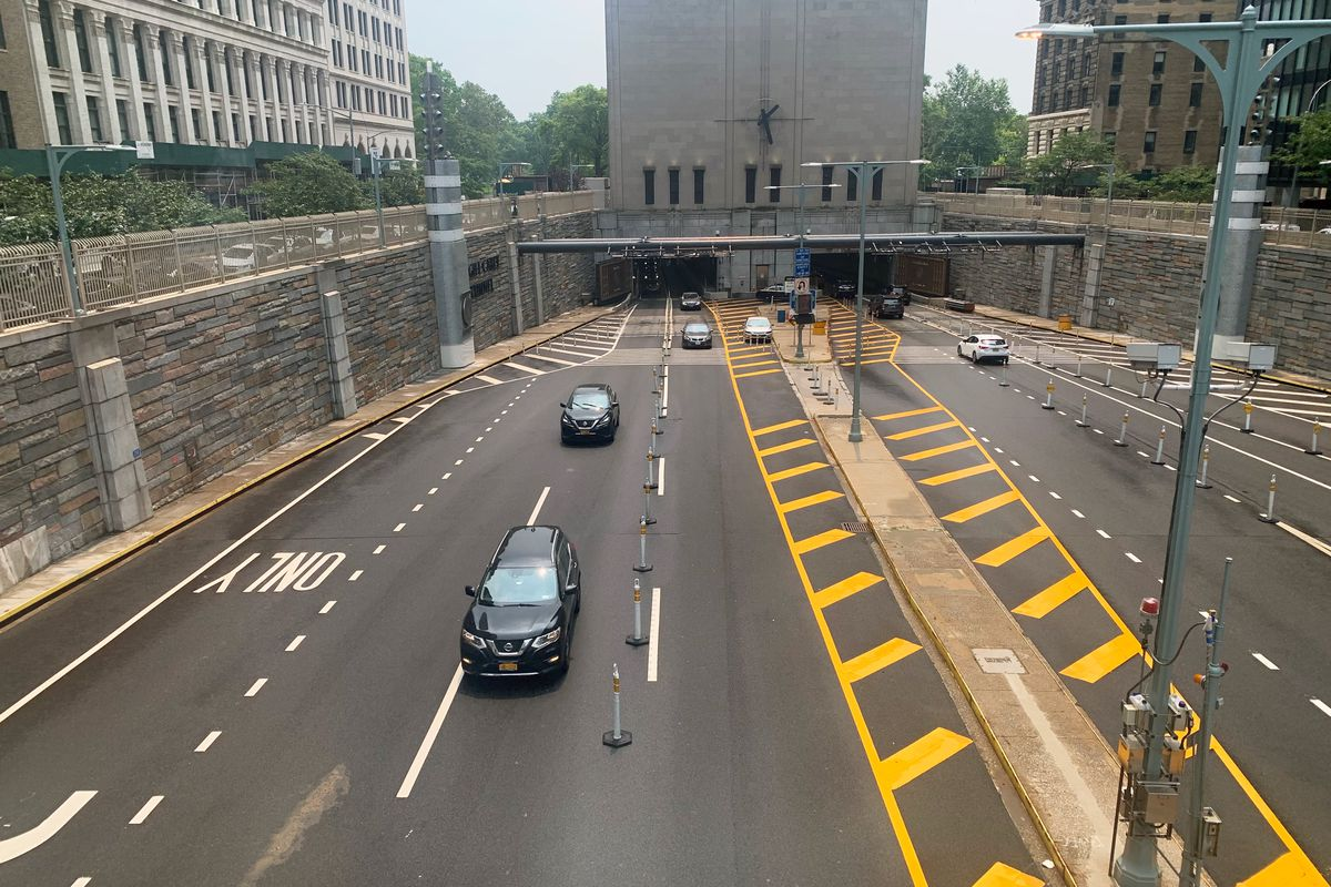 People drive out of the Hugh Carey Battery Tunnel in lower Manhattan, July 21, 2021.
