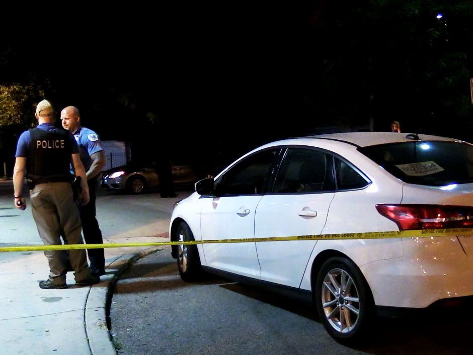 Police investigate a shooting about 10:30 p.m. Saturday, July 21, 2018 in the 200 block of West 106th St in Chicago. | Justin Jackson/ Sun-Times