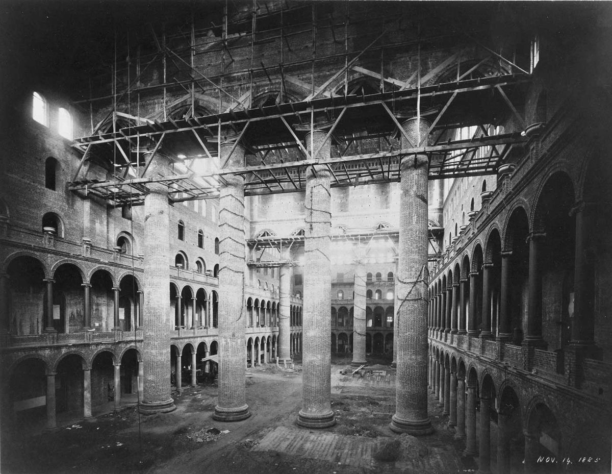 An old black-and-white photograph of the interior of a Renaissance Revival building.