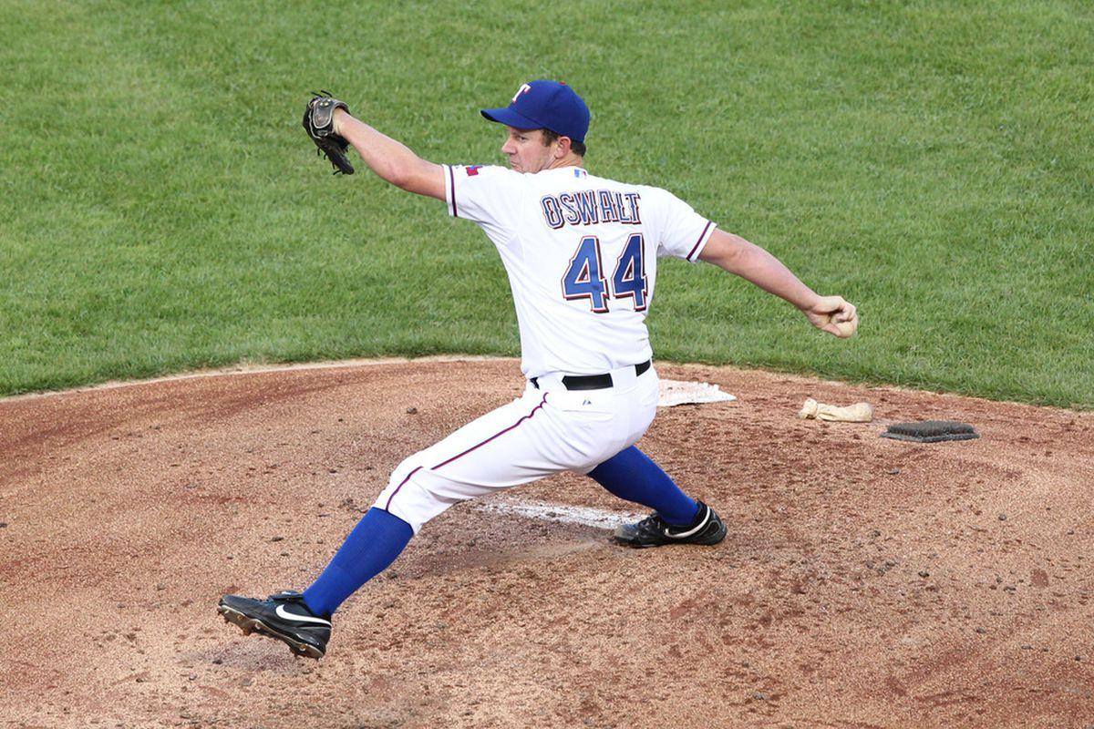 Jun 22, 2012; Arlington, TX, USA; Texas Rangers pitcher Roy Oswalt (44) pitches in the third inning against the Colorado Rockies at Rangers Ballpark.  Mandatory Credit: Matthew Emmons-US PRESSWIRE