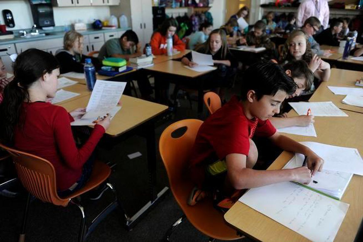Luciano Martingano works on answering questions on a worksheet during a social studies class at Meiklejohn Elementary in Arvada.