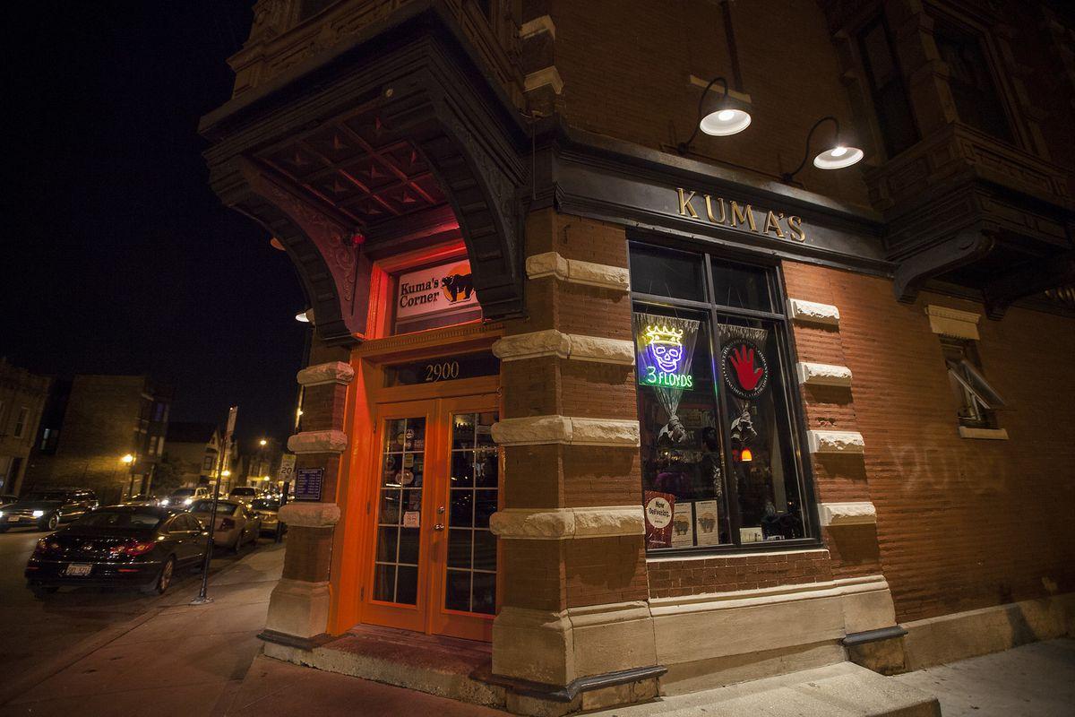 The exterior of a burger bar, Kuma's Corner, taken at night.